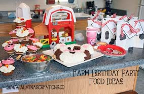 Farm Party Food Table Ideas with farm animal cupcakes tin buckets and farm animal plates and cups