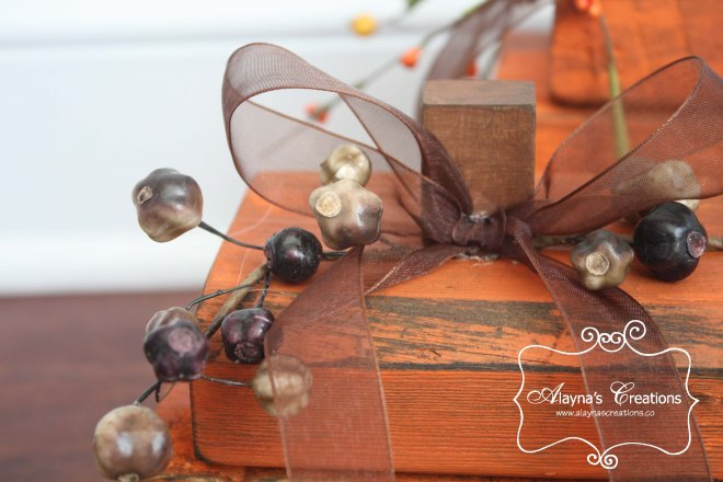DIY Wooden Pumpkins with berries and ribbon trim