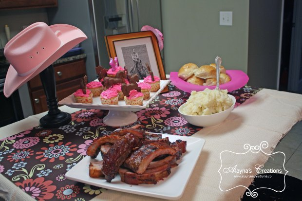 Horse Cowgirl Birthday Party Food Table Display includes cowboy hats and other western items