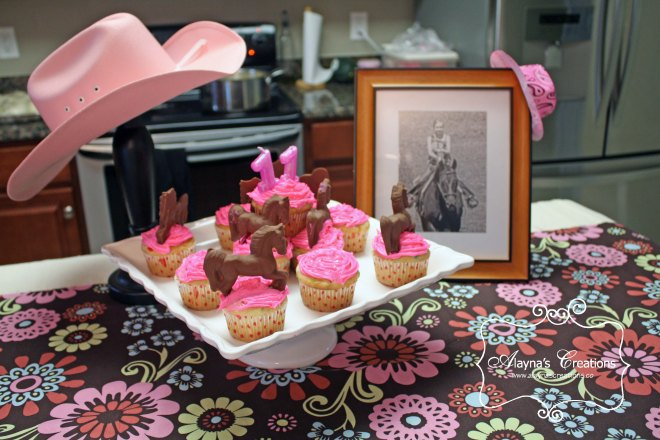 Horse Cupcakes with chocolate molded horses and pink frosting for cowgirl birthday party