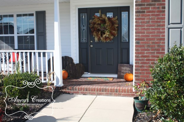 Fall front porch decorations for Halloween and Thanksgiving with pumpkins