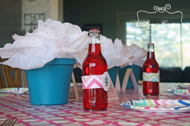 Cupcake Wars Birthday Party Tablescape featuring giant tissue cupcakes for the centerpiece