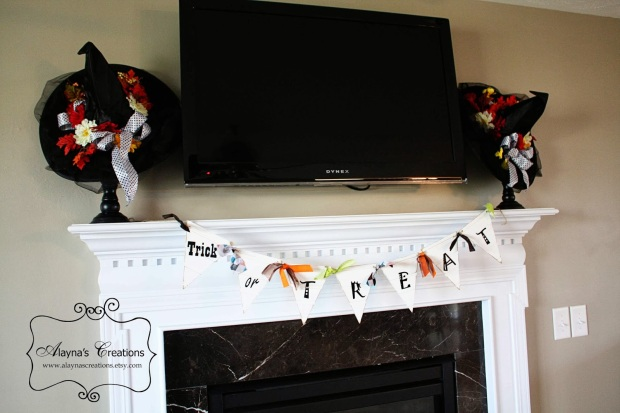 Halloween mantle with decorative witch hats and trick or treat pennant banner