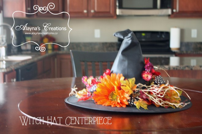 Witch Hat Centerpiece dress up an inexpensive costume hat with some silk flowers leaves and ribbon to make your own lovely centerpiece for your Halloween table or party