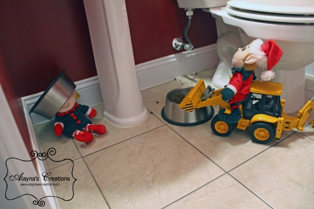 Elf on the Shelf Ideas Our elves decided to help feed the dog using the toy backhoe