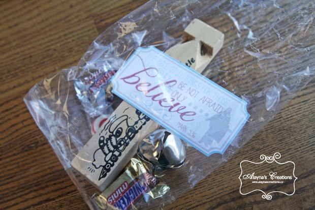 polar-express-party-favors-include-a-silver-bell-a-train-whistle-and-treats